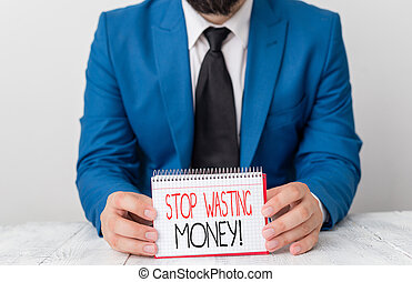 Writing note showing Stop Wasting Money. Business photo showcasing advicing demonstrating or group to start saving and use it wisely Man holds empty paper with copy space in front of him Space.