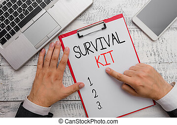Writing note showing Survival Kit. Business photo showcasing Emergency Equipment Collection of items to help someone.