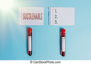 Writing note showing Sustainable. Business concept for the ability to be sustained, supported, upheld, or confirmed Blood sample vial medical accessories ready for examination