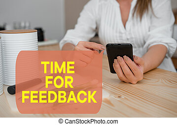 Writing note showing Time For Feedback. Business photo showcasing information about reactions to a product or services woman using smartphone and technological devices inside the home.