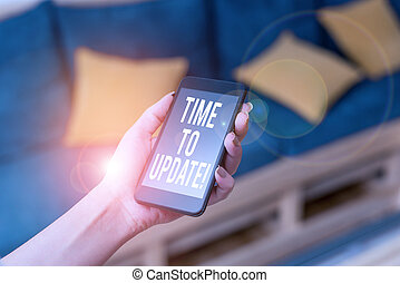 Writing note showing Time To Update. Business photo showcasing this is right moment to make something more modern new woman using smartphone and technological devices inside the home.