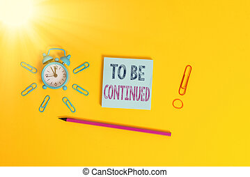 Writing note showing To Be Continued. Business photo showcasing indicate that the story continues in the next episode Alarm clock wakeup clips rubber band pencil notepad colored background.