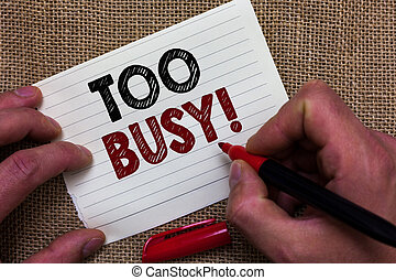 Writing note showing Too Busy. Business photo showcasing No time to relax no idle time for have so much work or things to do Man's hand hold white paper with symbolic letter jute sack background.