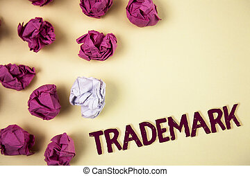 Writing note showing  Trademark. Business photo showcasing Legally registered Copyright Intellectual Property Protection written on Plain background Crumpled Paper Balls next to it.