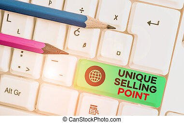 Writing note showing Unique Selling Point. Business photo showcasing Differentiate a Product Specific Features and Benefits White pc keyboard with note paper above the white background.