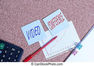 Writing note showing Video Conference. Business photo showcasing showing in remote places hold facetoface meetings Desk notebook paper office paperboard study supplies chart.