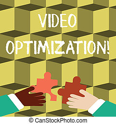 Writing note showing Video Optimization. Business photo showcasing to ensure or improve consumer viewing experience Hands Holding Jigsaw Puzzle Pieces about Interlock the Tiles.