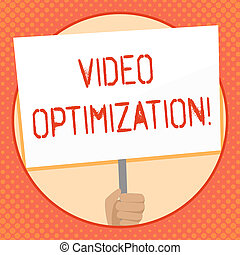 Writing note showing Video Optimization. Business photo showcasing to ensure or improve consumer viewing experience Hand Holding White Placard Supported for Social Awareness.