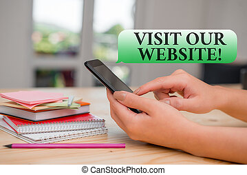 Writing note showing Visit Our Website. Business photo showcasing visitor who arrives at web site and proceeds to browse woman using smartphone and technological devices inside the home.