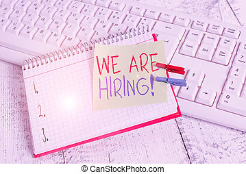 Writing note showing We Are Hiring. Business photo showcasing recently you employ someone or pay someone to do particular job notebook reminder clothespin with pinned sheet light wooden.