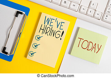 Writing note showing We Are Hiring. Business photo showcasing recently you employ someone or pay someone to do particular job Paper with copy space and keyboard above orange background table.