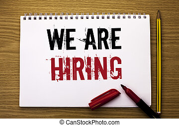 Writing note showing  We Are Hiring. Business photo showcasing Talent Hunting Job Position Wanted Workforce HR Recruitment written on Notebook Book on the wooden background Marker and Pencil.