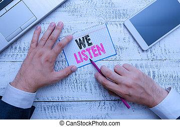 Writing note showing We Listen. Business photo showcasing ...