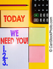 Writing note showing We Need You. Business photo showcasing asking someone to work together for certain job or target Colored empty papers with copy space on the yellow background table.