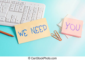 Writing note showing We Need You. Business photo showcasing asking someone to work together for certain job or target Paper blue keyboard office study notebook chart numbers memo.
