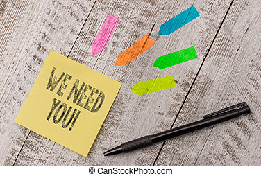 Writing note showing We Need You. Business photo showcasing asking someone to work together for certain job or target Note paper and line arrow stickers on the top of wooden table desk.