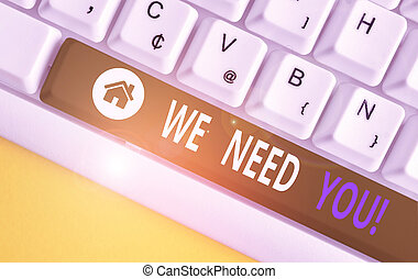Writing note showing We Need You. Business photo showcasing asking someone to work together for certain job or target White pc keyboard with note paper above the white background.