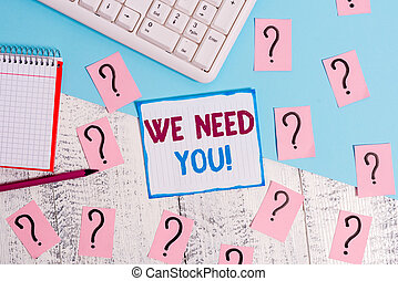 Writing note showing We Need You. Business photo showcasing asking someone to work together for certain job or target Writing tools and scribbled paper on top of the wooden table.