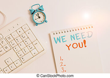 Writing note showing We Need You. Business photo showcasing asking someone to work together for certain job or target Keyboard with empty note paper and pencil white background.