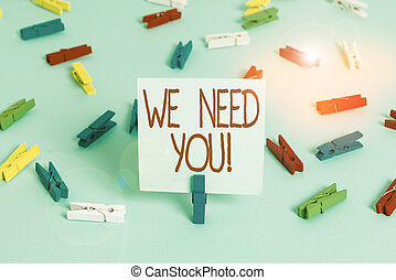 Writing note showing We Need You. Business photo showcasing asking someone to work together for certain job or target Colored clothespin papers empty reminder blue floor officepin.
