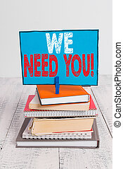 Writing note showing We Need You. Business photo showcasing asking someone to work together for certain job or target pile stacked books notebook pin color reminder white wooden.