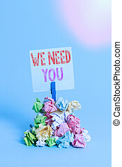 Writing note showing We Need You. Business photo showcasing asking someone to work together for certain job or target Reminder pile colored crumpled paper clothespin wooden space.
