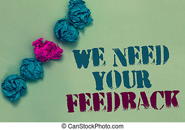 Writing note showing We Need Your Feedback. Business photo showcasing Give us your review thoughts comments what to improve Drawn blue and red words teal color paper lump mid pink on blue floor.