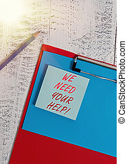 Writing note showing We Need Your Help. Business photo showcasing asking someone to stand with you against difficulty Clipboard blank paper sheet pencil notepad old retro wooden background.