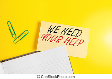 Writing note showing We Need Your Help. Business photo showcasing asking someone to stand with you against difficulty Empty orange paper with copy space on the yellow table.