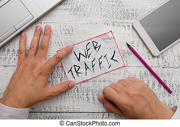 Writing note showing Web Traffic. Business photo showcasing Amount of data sent and received by visitors to a website.