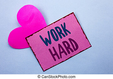 Writing note showing  Work Hard. Business photo showcasing Struggle Success Effort Ambition Motivation Achievement Action written on Pink Sticky Note Paper on the Plain background with Heart.