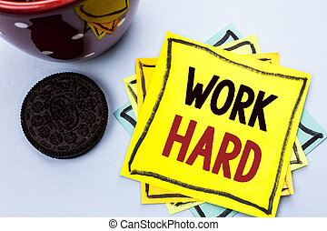 Writing note showing  Work Hard. Business photo showcasing Struggle Success Effort Ambition Motivation Achievement Action written on Yellow Sticky Note Paper on the plain background Cup.