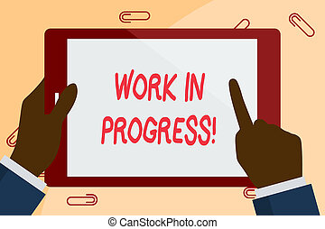 Writing note showing Work In Progress. Business photo showcasing unfinished project that still added to or developed Businessman Hand Holding and Pointing Colorful Tablet Screen.