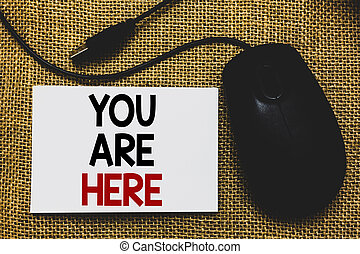 Writing note showing You Are Here. Business photo showcasing This is your location reference point global positioning system Traditional mouse alongside white page with written words.