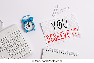 Writing note showing You Deserve It. Business photo showcasing should have it because of their qualities or actions Blank paper with copy space on the table with clock and pc keyboard.