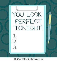 Writing note showing You Look Perfect Tonight. Business photo showcasing Flirting beauty appreciation roanalysistic feelings Sheet of Bond Paper on Clipboard with Ballpoint Pen Text Space.