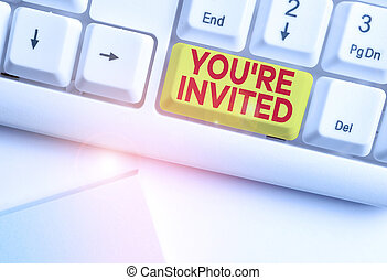Writing note showing You Re Invited. Business photo showcasing Please join us in our celebration Welcome Be a guest White pc keyboard with note paper above the white background.