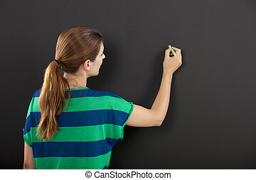 Writing on a chalkboard