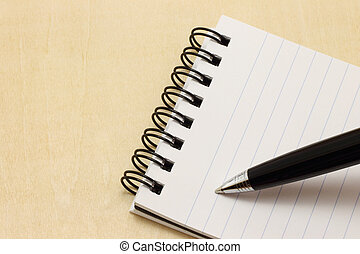 Writing pen on the notepad