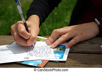 Writing postcard