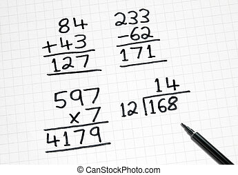 Writing simple maths sums on square paper.