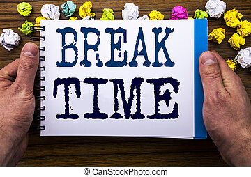 Writing text showing Break Time. Business concept for Stop Pause From Work Workshop written on notepad notebook book on the wooden wood background with man businessman hand and finger.