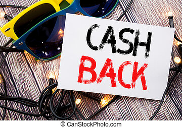 Writing text showing Cash Back Cashback. Business concept for Money Assurance written on sticky note with copy space on old wood wooden background with sunglasses