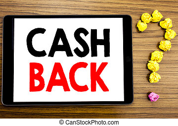 Writing text showing Cash Back Cashback. Business concept for Money Assurance written on tablet computer on the wooden background with question mark made of folded paper.