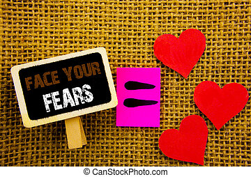 Writing text showing  Face Your Fears. Concept meaning Challenge Fear Fourage Confidence Brave Bravery written on blackboard equation Meaning Love Heart on the textured background