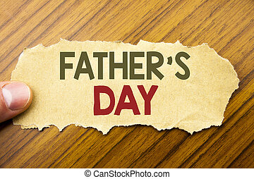 Writing text showing Father s Day. Business concept for Dad Celebration Event written on note paper on the wooden background with human finger. Vintage style.
