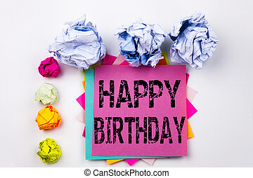 Writing text showing Happy Birthday written on sticky note in office with screw paper balls. Business concept for Anniversary Celebration on the white isolated background.