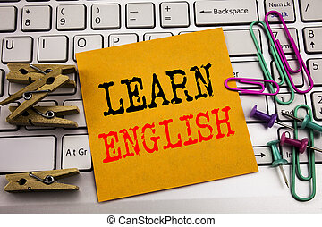 Writing text showing Learn English. Business concept for Language School written on sticky note paper on the white keyboard background.