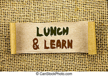 Writing text showing Lunch And Learn. Business photo showcasing Presentation Training Board Course written on Tear Sticky Note Paper on the textured background