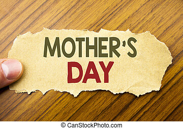 Writing text showing Mother Day. Business concept for Mom Greetings Celebration written on note paper on the wooden background with human finger. Vintage style.